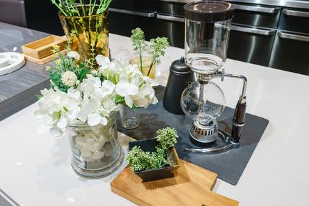 Siphon vacuum coffee maker on white countertop kitchen interior Stock Photo