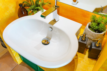 Interior of bathroom with sink basin faucet and mirror. Modern design of bathroom Stock Photo