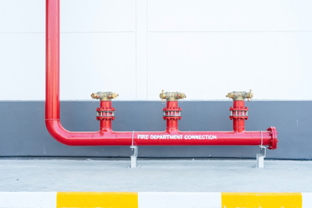 Fire hydrant, fire department connection, two way valve connect outside of building. Stock Photo