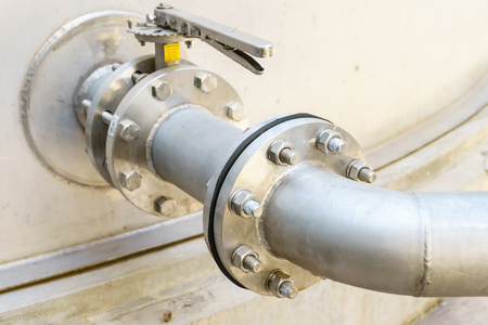 Flanges pipe with nuts and bolts. Pipeline for water tank industry