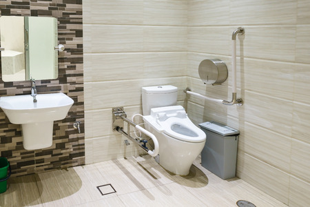 Interior of bathroom for the disabled or elderly people. Handrail for disabled and elderly people in the bathroom