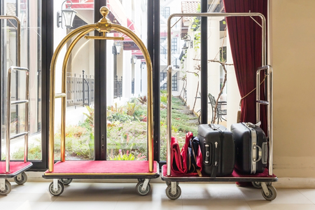 Hotel luggage cart  baggage trolley in the hotel lobby hallway background or Bellmans luggage cart