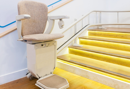 Automatic stair lift on staircase for elderly people and disabled persons