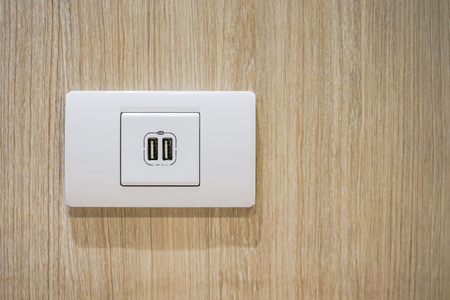 USB socket port with USB signage icon on wooden wall background, Prepared to use.