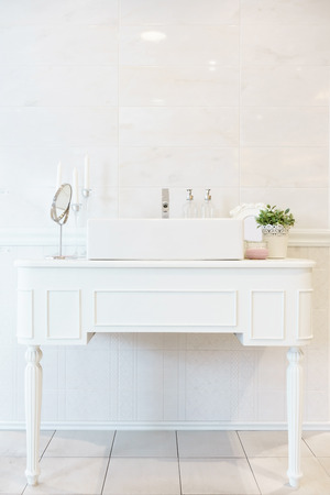 Interior of bathroom with sink basin faucet and mirror. Modern design of bathroom Standard-Bild