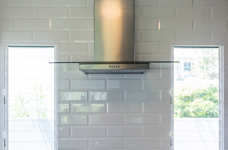 close up modern of kitchen hood made from stainless for exhaust dust and smoke, Kitchen Wall Mount Range Hood with touch control. Cooking Hoods. Kitchen Appliances 版權商用圖片