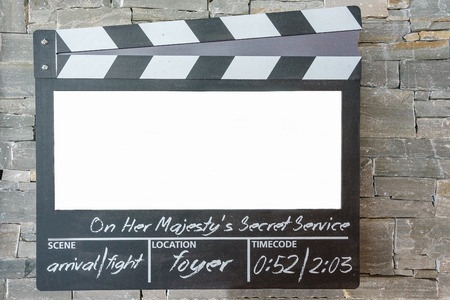 Blank mock up of clapper board,Movie clapper with copy space for your text message or content onstone wall background Archivio Fotografico