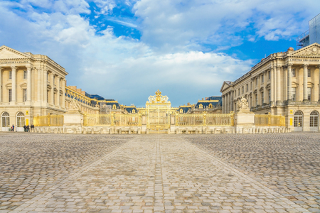 Main entrance of Versailles Palace, Versailles, France on april 08, 2018. Palace Versailles was a royal chateau. It was added to UNESCO list of World Heritage Sites.