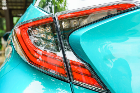 Detail on the rear light of a car. New led taillight by night. Stock Photo