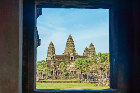 Ancient temple Angkor Wat from across the lake. The largest religious monument in the world. Siem Reap, Cambodia