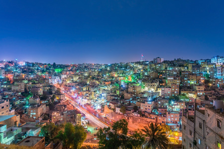 Cityscape Amman downtown at dusk, Panoramic view from the citadel hill. Capital of Jordan.