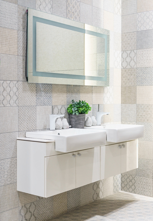 Front view of a white vanity top with two sinks and a stylish mirror in bathroom interior, Concept of a hotel or a luxury apartment design. 版權商用圖片
