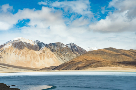 Landscape image of Pangong lake and mountains view background in Ladakh, India. Pangong is an endorheic lake in the Himalayas situated at a height of about 4,350 m Stock Photo