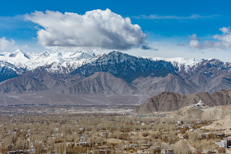Aerial view of Leh Ladakh City of Kashmir in India with background of Himalaya mountain against blue sky