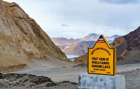 First view of Beautiful Pangong Lake through mountains, Ladakh, Jammu and Kashmir, India Stock Photo