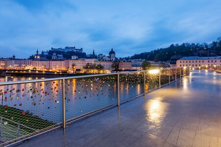 Beautiful view of Salzburg skyline with Festung Hohensalzburg and Salzach river at blue hour, Salzburger Land, Austria
