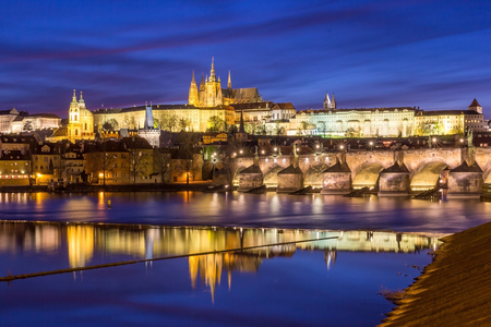 Panorama of Prague Castle and St. Vitus cathedral in twilight with dramatic sky. Prague, Czech Republic 에디토리얼