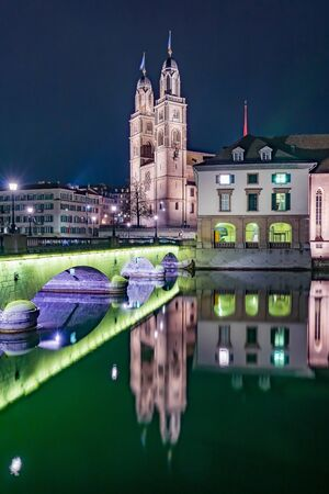 View of Grossmunster and Zurich old town from Limmat river. The Grossmunster is a Romanesque-style Protestant church in Zurich, Switzerland.