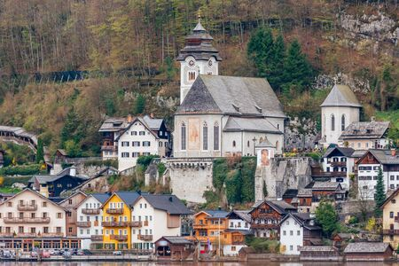 Town Hallstatt with mountain lake and salt mines. Alpine massif, beautiful canyon in Austria. Salzburg Alpine valley in summer, clear water. Destination for vacation, hiking and relaxation. 스톡 콘텐츠