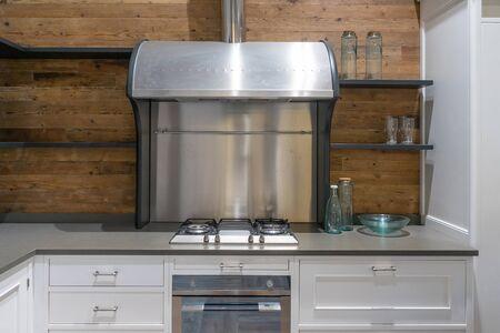 Bright modern kitchen with stainless steel appliances. Interior design. Archivio Fotografico - 129295502