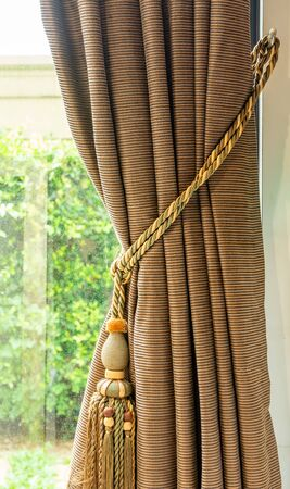 Beautiful curtains with ring-top rail, Curtain interior decoration in living room Archivio Fotografico - 129295485