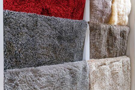 Colorful carpet samples in the shop store Archivio Fotografico - 129295490