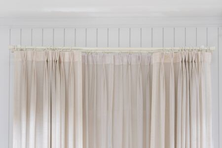Beautiful curtains with ring-top rail, Curtain interior decoration in living room Archivio Fotografico - 129295493