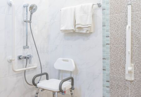 Interior of bathroom for the disabled or elderly people. Handrail for disabled and elderly people in the bathroom Archivio Fotografico - 129295369