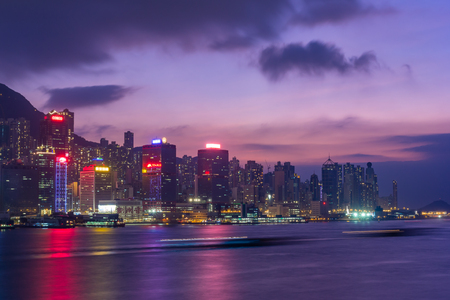 Hong Kong skyline cityscape downtown skyscrapers over Victoria Harbour in the evening. Hong Kong, China
