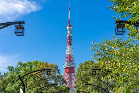 Tokyo Tower with blue sky in Tokyo. The structure is an Eiffel Tower-inspired lattice tower that is painted white and international orange to comply with air safety regulations. Archivio Fotografico - 132165135