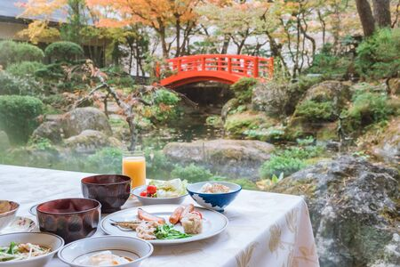 Typical Japanese breakfast with japanese garden with white stone and green plant, Japanese cuisine Archivio Fotografico - 133871360