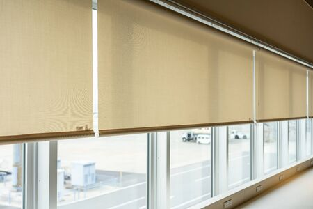 Roll blinds to protect sunlight and lighting to decorate the airplane. Window in the Interior Roller Blinds. Beautiful Blinds on the window Archivio Fotografico