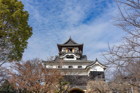 Inuyama castle and the garden in front of the castle in Aichi, Japan. This is a famous place of cherry blossoms in Inuyama City and there are about 40 cherry trees here.