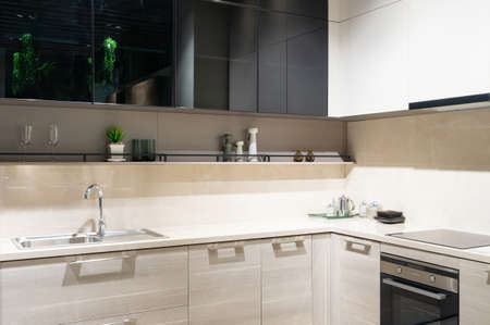 Bright modern kitchen with stainless steel appliances. Interior design. Фото со стока