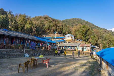 View of Forest Camp Guest House & Restaurant on Mardi Himal trek at blue sky, Annapurna mountain range in Nepal Редакционное