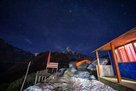 Machapuchare peak in moon light with star, Mardi himal trek, Nepal Фото со стока