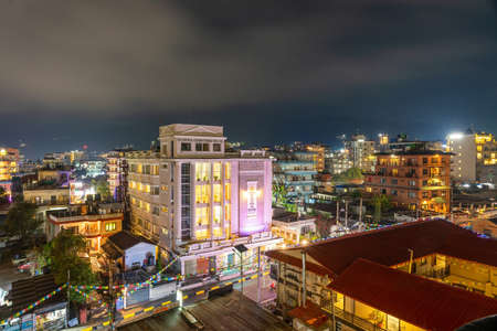 Night view of illuminated Pokhara city of Nepal seen from the rooftop of the hotel