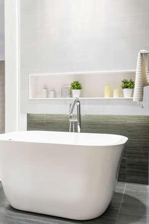 Modern bathroom interior with minimalistic shower and lighting, white toilet, sink and bathtub Zdjęcie Seryjne