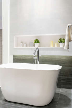 Modern bathroom interior with minimalistic shower and lighting, white toilet, sink and bathtub Stock fotó