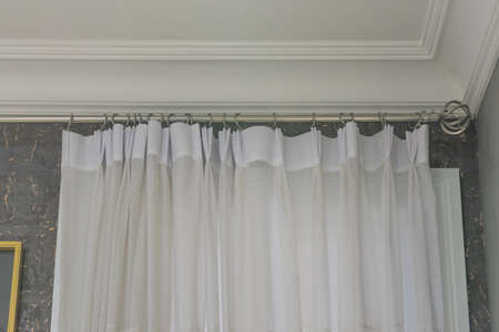 Beautiful curtains with ring-top rail, Curtain interior decoration in living room Фото со стока - 151693920