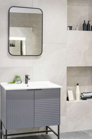 Bathroom interior with white wall, vintage furniture, towels, toilet and sink Фото со стока - 155997958