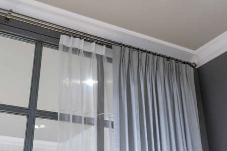 Beautiful curtains with ring-top rail, Curtain interior decoration in living room Фото со стока - 151693914
