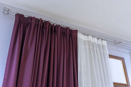 Beautiful curtains with ring-top rail, Curtain interior decoration in living room Фото со стока - 151694015