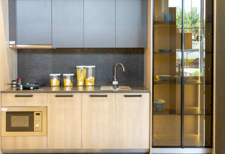 Bright modern kitchen with stainless steel appliances. Interior design. Фото со стока - 151694851