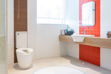 Bathroom interior with white wall, vintage furniture, towels, toilet and sink Фото со стока - 152115782