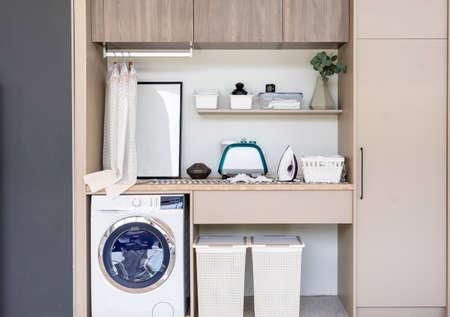 Interior of home laundry room with modern washing machine Фото со стока - 151694737