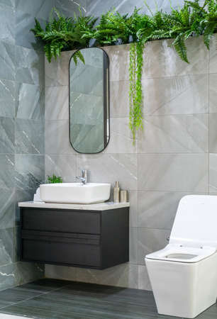 Bathroom interior with white wall, vintage furniture, towels, toilet and sink Фото со стока - 152115774