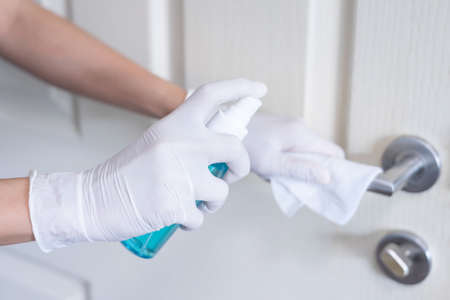 Deep cleaning for Covid-19 disease prevention. alcohol,disinfectant spray on Wipes of banister in home for safety,infection of Covid-19 virus,contamination,germs,bacteria for good hygiene. Concept of heath and safety Фото со стока - 152115789