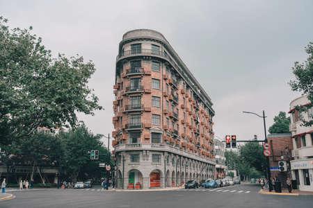 SHANGHAI, CHINA - OCTOBER 09, 2019: People walking at Wukang Mansion or Wukang Building, formerly known as the Normandie Apartments on Wukang Road in Shanghai, China. Фото со стока - 152282049