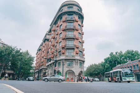 SHANGHAI, CHINA - OCTOBER 09, 2019: People walking at Wukang Mansion or Wukang Building, formerly known as the Normandie Apartments on Wukang Road in Shanghai, China. Фото со стока - 152285003